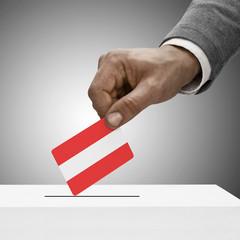Black male holding flag. Voting concept - Austria