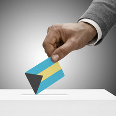 Black male holding flag. Voting concept - Bahamas