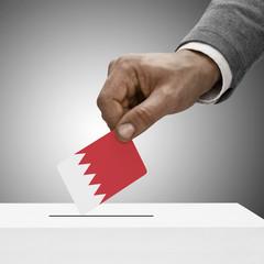 Black male holding flag. Voting concept - Bahrain