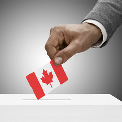 Black male holding flag. Voting concept - Canada