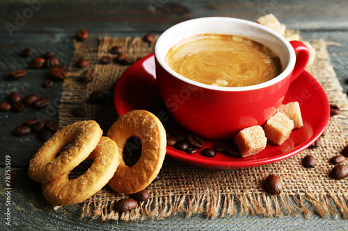 Cup of coffee and tasty cookies