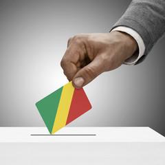 Black male holding flag. Voting concept - Congo-Brazzaville - Re