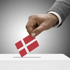 Black male holding flag. Voting concept - Denmark