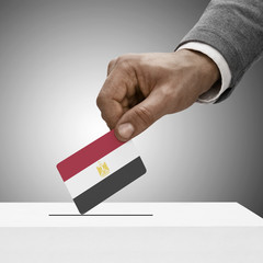 Black male holding flag. Voting concept - Arab Republic of Egypt