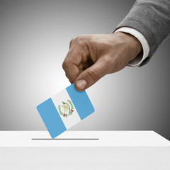 Black male holding flag. Voting concept - Guatemala
