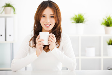 happy asian young woman drinking coffee