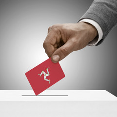 Black male holding flag. Voting concept - Isle of Man
