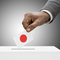 Black male holding flag. Voting concept - Japan