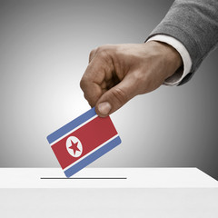 Black male holding flag. Voting concept - North Korea