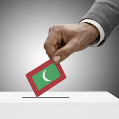 Black male holding flag. Voting concept - Maldives