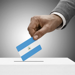 Black male holding flag. Voting concept - Nicaragua