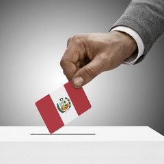 Black male holding flag. Voting concept - Peru