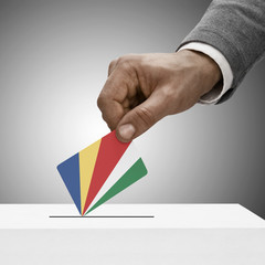 Black male holding flag. Voting concept - Republic of Seychelles