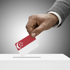 Black male holding flag. Voting concept - Singapore