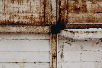 Rusty sheet of metal painted in white