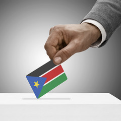 Black male holding flag. Voting concept - South Sudan