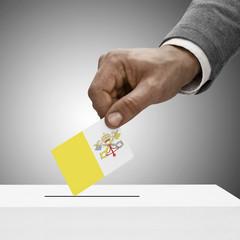 Black male holding flag. Voting concept - Vatican City
