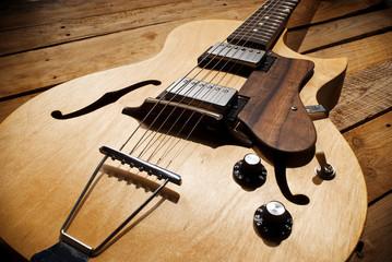 vintage jazz guitar on wood