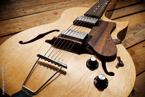 vintage jazz guitar on wood - 78755751