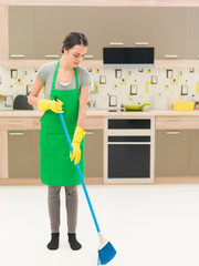 sweeping the kitchen floor