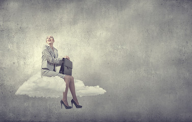 Businesswoman on cloud
