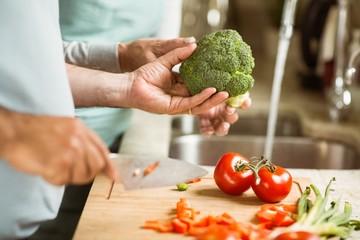 Mature couple preparing vegetables together