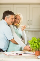 Mature couple preparing vegetarian meal together