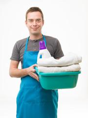 happy husband doing laundry