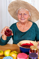 One Mature woman with straw hat and homemade jam