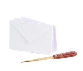 Special knife next to pile of envelopes