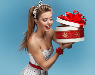 Beautiful happy woman opening gift box
