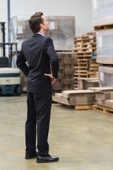 Warehouse manager standing hands on hips
