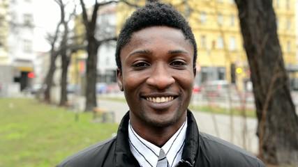 handsome black man laughs - urban street - closeup