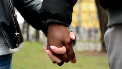 couple in love - happy multicultural couple holding hands