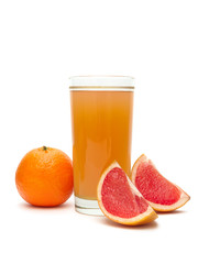 fruit juice in a glass, tangerine and grapefruit on a white back