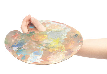 Hand holding a wooden palette isolated