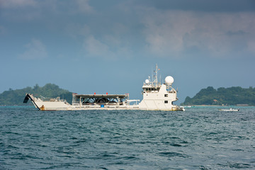 Cargo ship sailing in the Indian ocean near Seychelles