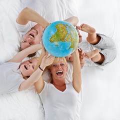 Happy family with world ball