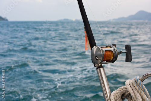 Tuinposter Vissen Fishing rod and reel on a boat