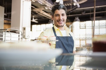 Portrait of a smiling worker in apron