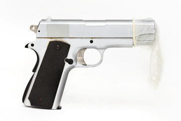 Gun protected by a condom. safe sex.