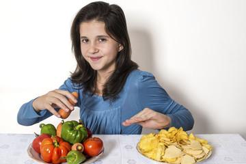 Child eats fresh vegetables - refuse chips