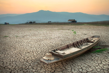 wood boat on cracked earth