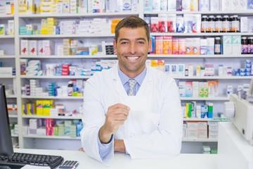 Handsome pharmacist holding paper
