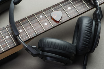 Electric guitar with headphones and mediator