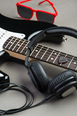 Electric guitar with headphones and sunglasses