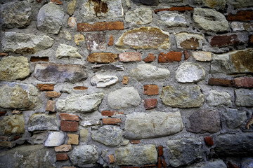 Concrete wall with stones. Color photo