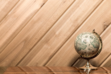 Old World Globe against Plank Wall with Copy Space