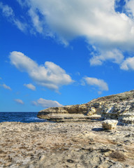 rocky shore under clouds in Sardinia