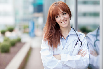 business portrait of smiling young female doctor